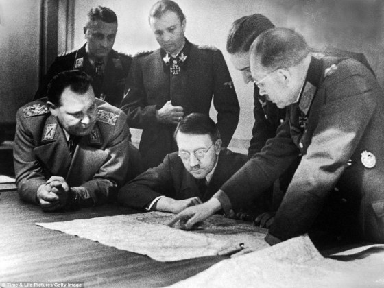 Development phase: Here, German Fuhrer and Reichskanzler Adolf Hitler and members of his General Staff review plans for 'Operation Bodenplatte,' an airstrike in support of the Ardennes offensive.