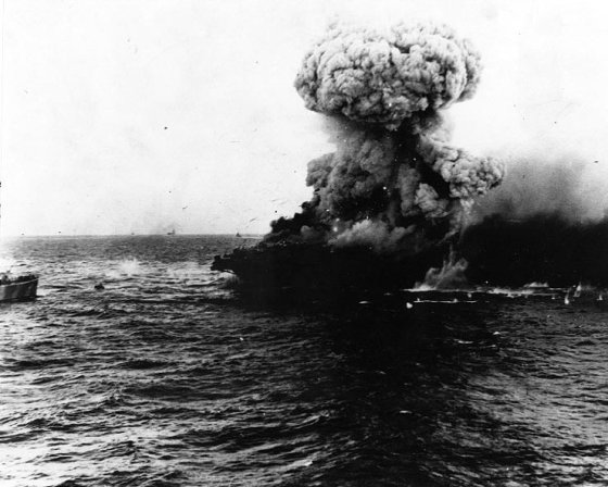 United States Navy aircraft carrier Lexington explodes on 8 May 1942, several hours after being damaged by a Japanese carrier air attack.