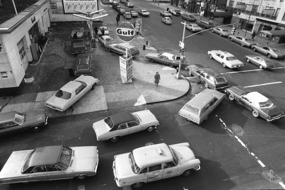 On Dec. 23, 1973, cars lined up in two directions at a gas station in New York City.